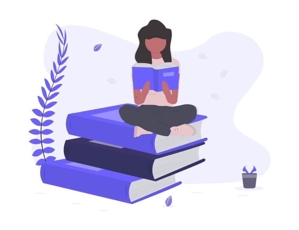 本の上に座って読書をする人