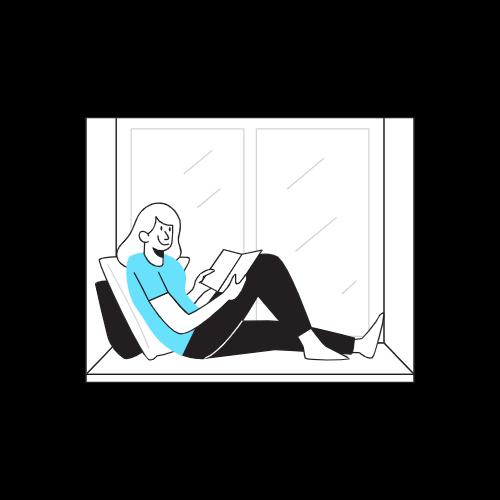 窓際でくつろいで本を読む